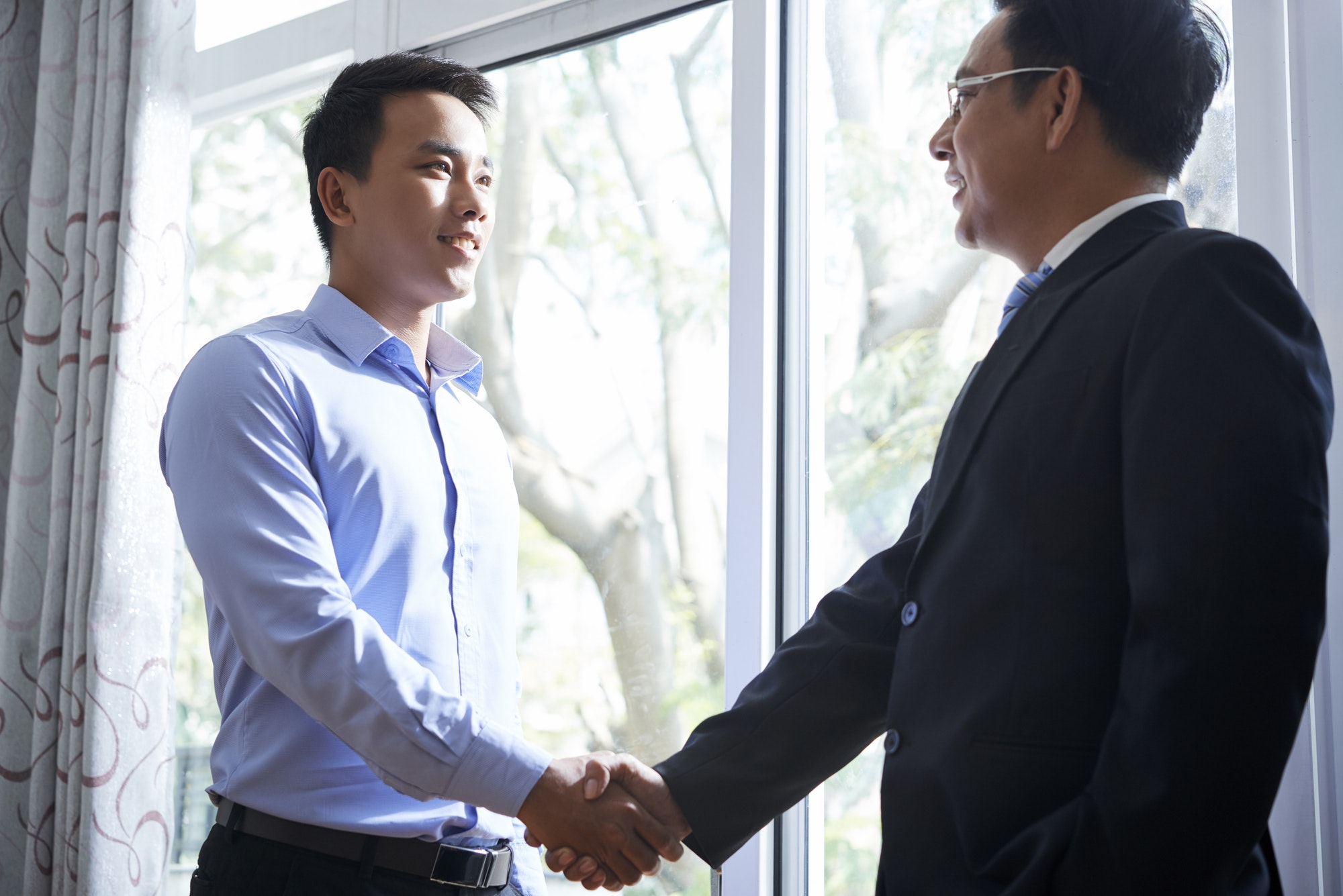 Businessman shaking hand of colleague